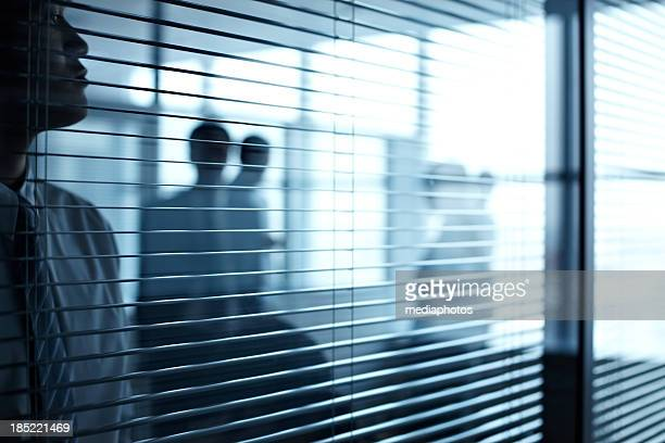 Workers behind the blinds