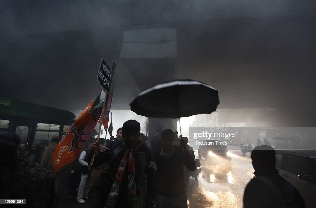 BJP workers blocking traffic during a protest march against diesel price hike on January 18, 2013 in New Delhi, India. Oil firms increased the price of diesel by Rs 0.45 a litre, while cutting the petrol price cut by Rs. 0.25 per litre.