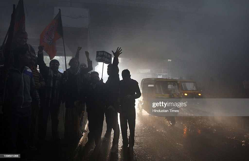 BJP workers blocking traffic during a protest march against diesel price hike on January 18, 2013 in New Delhi, India. Oil firms increased the price of diesel by Rs 0.45 a litre, while cutting the petrol price by Rs. 0.25 per litre.