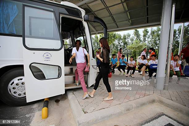 Workers board a company bus at the Samsung Electronics Vietnam Co Plant at Yen Phong Industrial Park in Bac Ninh Province Vietnam on Thursday Sept 1...