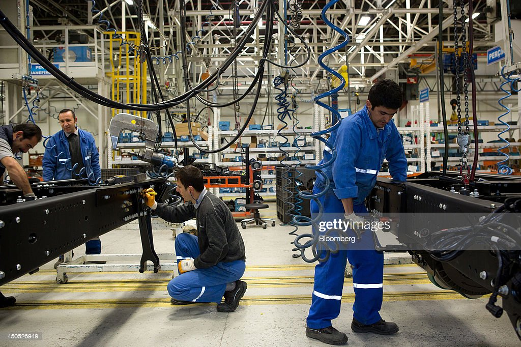 Workers bolt together chassis frames for Ford Cargo trucks on the production line at Ford Otosan, the joint venture between Ford Motor Co.'s Ford Otomotiv Sanayi AS and Koc Holding AS, in Eskisehir, Turkey, on Monday, Nov. 18, 2014. Ford Otomotiv Sanayi AS chief executive officer Haydar Yenigun said in September Turkey is about to 'lose the diamond' which is light commercial vehicle production due to government policies such as tax hikes, ban on their lease, Dunya newspaper says. Photographer: Kerem Uzel/Bloomberg via Getty Images