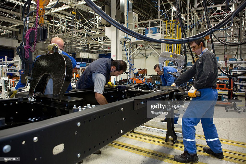 Workers bolt together the chassis frame for a Ford Cargo truck on the production line at Ford Otosan, the joint venture between Ford Motor Co.'s Ford Otomotiv Sanayi AS and Koc Holding AS, in Eskisehir, Turkey, on Monday, Nov. 18, 2014. Ford Otomotiv Sanayi AS chief executive officer Haydar Yenigun said in September Turkey is about to 'lose the diamond' which is light commercial vehicle production due to government policies such as tax hikes, ban on their lease, Dunya newspaper says. Photographer: Kerem Uzel/Bloomberg via Getty Images