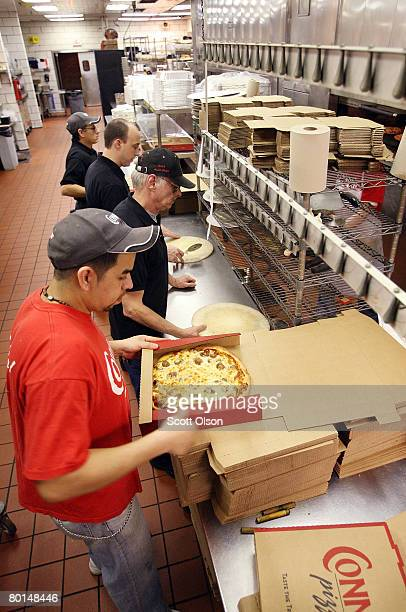 Workers box an order for 200 pizzas as they come out of the oven at Connie's Pizza on March 6 2008 in Chicago Illinois The cost of flour a key...