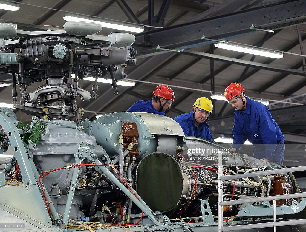 Workers build a helicopter at the Military Aviation Factory No1 in Lodz after signing an agreement on April 4, 2013. Eurocopter, the largest helicopter manufacturer in the world, signed a contract with the Military Aviation Factory No1 in Lodz. The agreement is an order for 70 helicopters for the Polish Army.