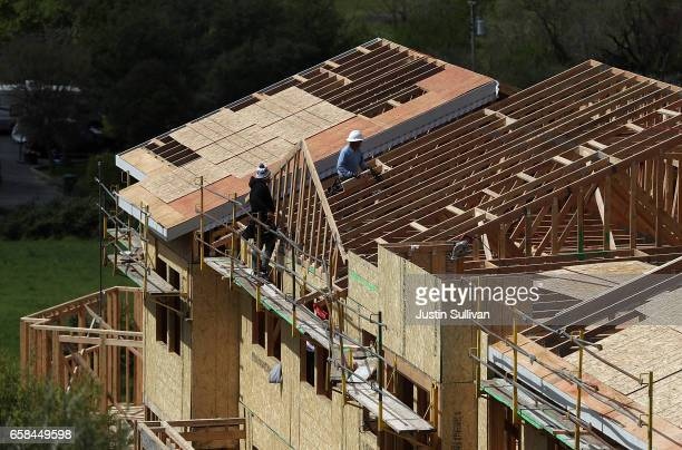 Workers build a home at a housing development on March 27 2017 in Petaluma California According to a study by real estate consultant the Rosen...