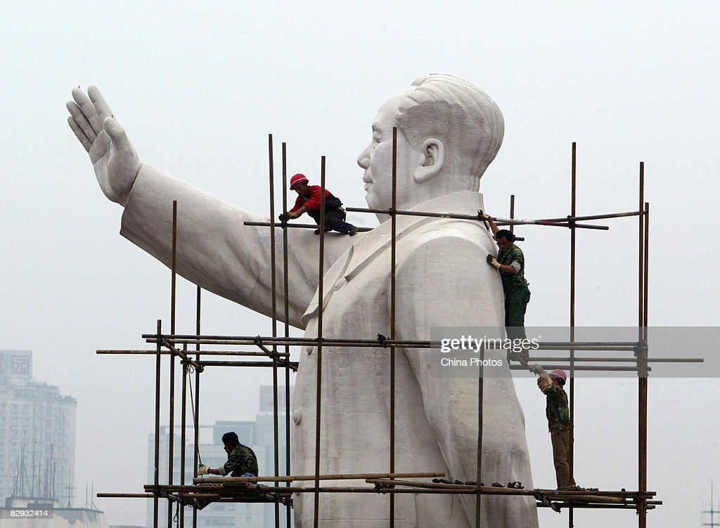 Workers build a scaffold to clean the statue of former Chinese leader Mao Zedong to prepare for the upcoming National Day Holiday September 21 2008...