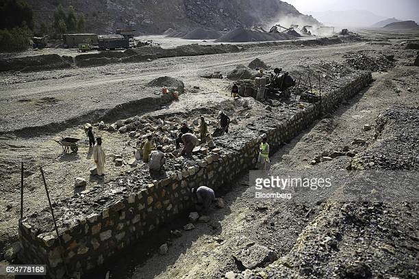 Workers build a wall at a roadbuilding site on the TorkhumJalalabad highway expansion project in Nangarhar Province Afghanistan on Wednesday Oct 19...