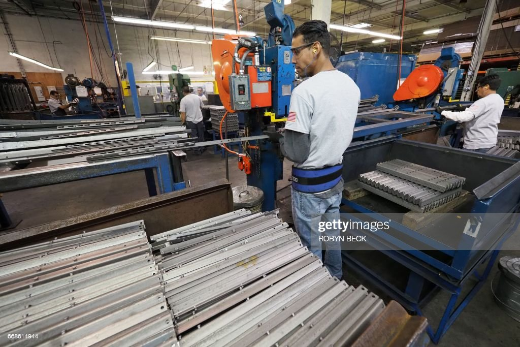 workers build bed frames at the hollywood bed frame company factory in commerce california - Bed Frames Los Angeles