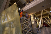Workers build sets in the court section of the Red carpet arrivals area that leads to the Dolby Theatre as preparations continue for the 88th Annual...