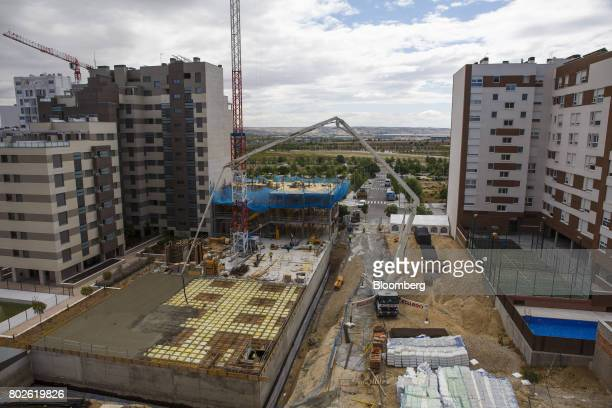 Workers build the concrete and steel floor foundations at the site of a new residential tower block under construction in Madrid on Wednesday June 28...