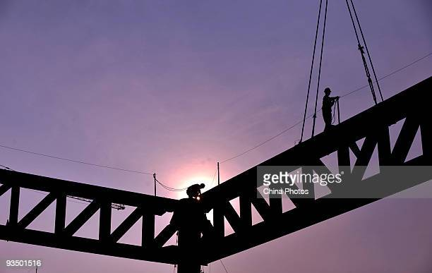 Workers build the girder of the main station building at the construction site of Chengdu East Railway Station on November 30 2009 in Chengdu of...