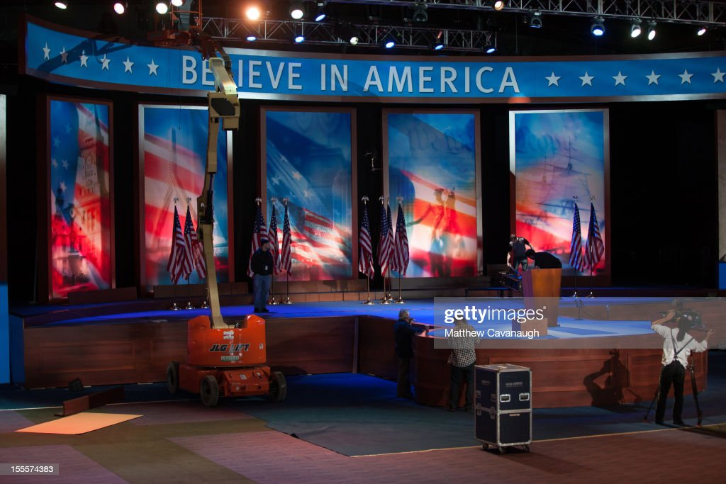 Workers build the stage for U.S. Republican presidential candidate, former Massachusetts Governor Mitt Romney's election night event, on November 5, 2012 in Boston, Massachusetts. National polls show that Romney and U.S. President Barack Obama are in a virtual dead heat in the race for the presidential election on Tuesday.