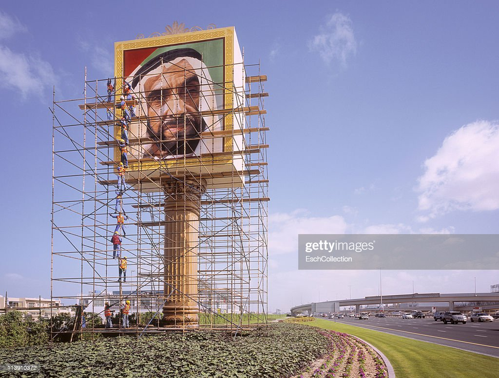 Workers building scaffolding at display of Sheikh : Stock Photo