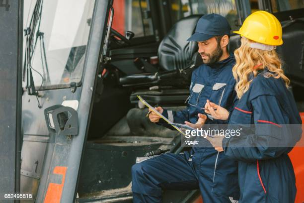 Workers by the forklift