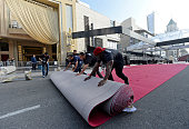 Workers Carlyon Prevost Ernest Jauregui and Eddie Padilla roll out the red carpet in preparation of 87th Annual Academy Awards at Dolby Theater...