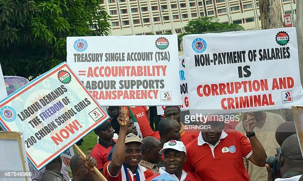 Workers carry banners march in support of anti corruption drive of the government during a rally in Abuja on September 10 2015 Workers under the...