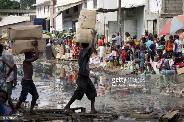 Workers carry boxed of goods on March 31 2007 at the Chinese market in Luanda Luanda is full of newly arrived Chinese who do business in many...