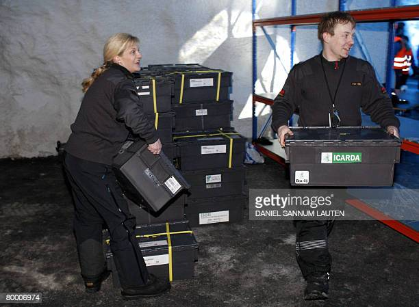 Workers carry boxes of seeds into the Svalbard Global Seed Vault after its official opening on February 26 2008 in Longyearbyen The Global Seed Vault...