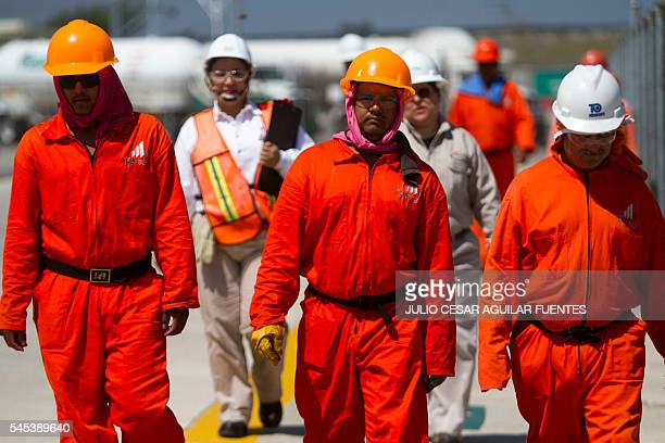PEMEX workers carry out an emergency drill in the liquefied gas distribution terminal in Monterrey Nuevo Leon Mexico on July 7 2016 / AFP / Julio...
