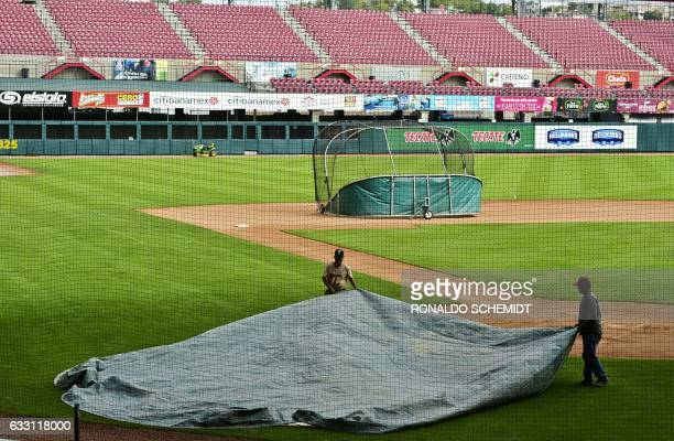 Workers carry out maintenance work in the Tomateros stadium in preparation for the Caribbean Baseball Series that will take place from February 1 to...