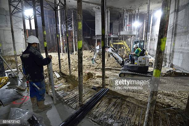 Workers carry out renovations on the third basement level of the Lutetia hotel on May 12 2016 in Paris The renovation of the prestigious Parisian...