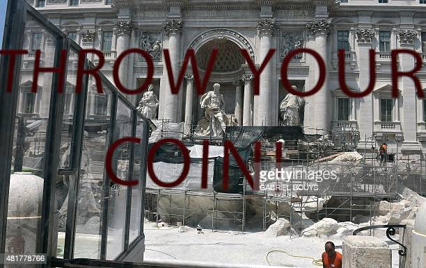 Workers carry out restoration work on the Trevi Fountain in central Rome on July 24 2015 Though the fountain has been drained for the renovation a...