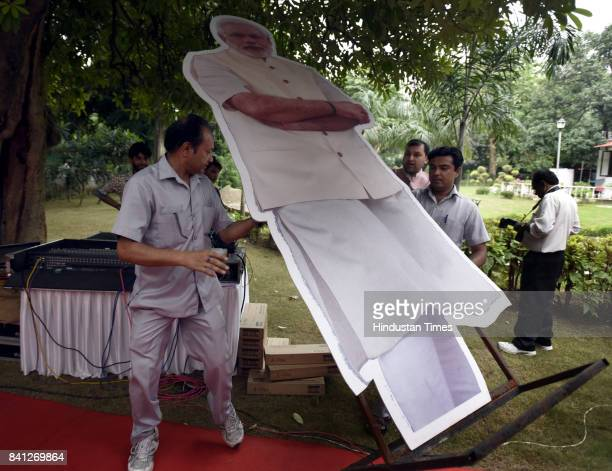 Workers carrying a cutout of Prime Minister Narendra Modi at Union Sports Minister Vijay Goel's residence on August 31 2107 in New Delhi India Indian...