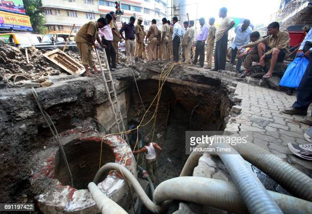 BMC workers carrying out work of repairing the pipeline at Nana Chowk which leaked creating shortage of water in the southern part of Mumbai on Monday