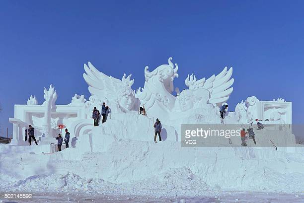 Workers carve the snow sculpture of 28th Harbin Sun Island International Snow Sculpture Art Expo on December 19 2015 in Harbin Heilongjiang Province...