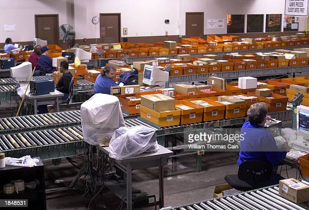 Workers catalog supplies as they are prepared for shipping at the Defense Distribution Center March 14 2003 in New Cumberland Pennsylvania The...