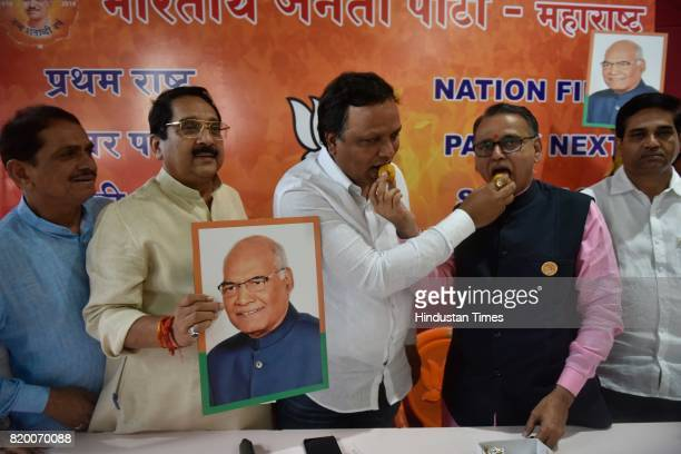 BJP workers celebrate after the results of Presidential election announced at BJP office on July 20 2017 in Mumbai India Ram Nath Kovind won by 66...
