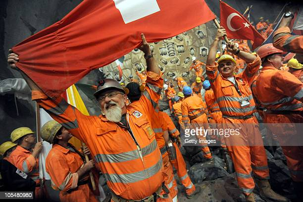Workers celebrate the break trough of the second shaft of Gotthard Tunnel on October 15 2010 in Sedrun Switzerland The world's longest tunnel which...