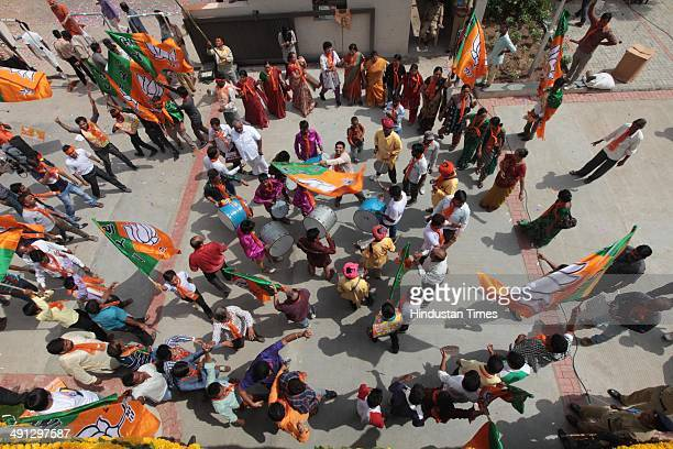 BJP workers celebrating outside BJP Headquarters in on May 16 2014 in Ahmedabad India Recording its best ever performance in its 34year existence the...