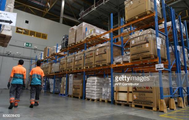 Workers check cargo at a Qatar Airways warehouse at the Hamad International Airport in Doha on July 20 2017 / AFP PHOTO / STRINGER