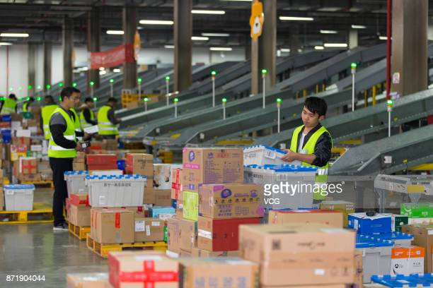 Workers check packages at the intelligent warehouse 'Suning cloud warehouse' of China's retail giant Suning on November 8 2017 in Nanjing Jiangsu...