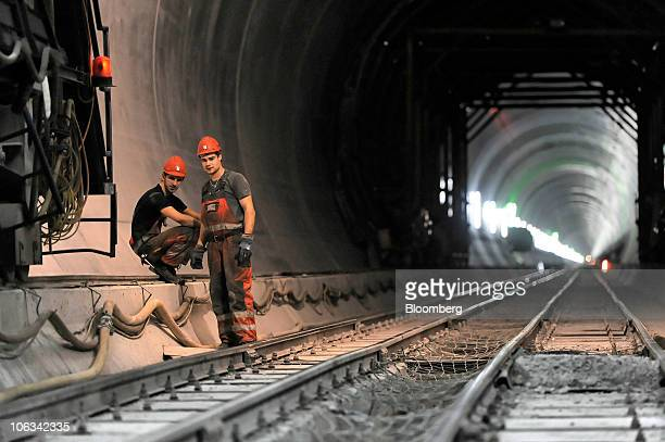 Workers check railway tracks in the Gotthard railway tunnel in Erstfeld Switzerland on Wednesday Oct 27 2010 When completed the tunnel will be the...