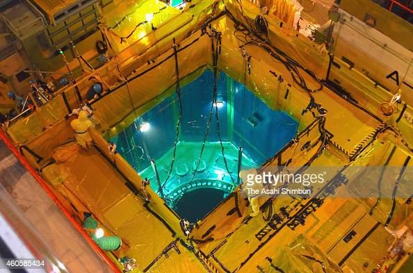 Workers check the No 1 reactor at the Kansai Electric Power Co Takahama Nuclear Power Plant on December 16 2014 in Takahama Fukui Japan Although the...