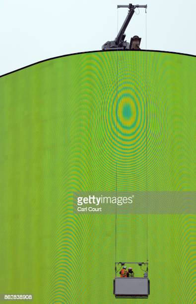 Workers check the Piccadilly Circus billboard as it displays a test screen on October 18 2017 in London England After nine months of works to upgrade...