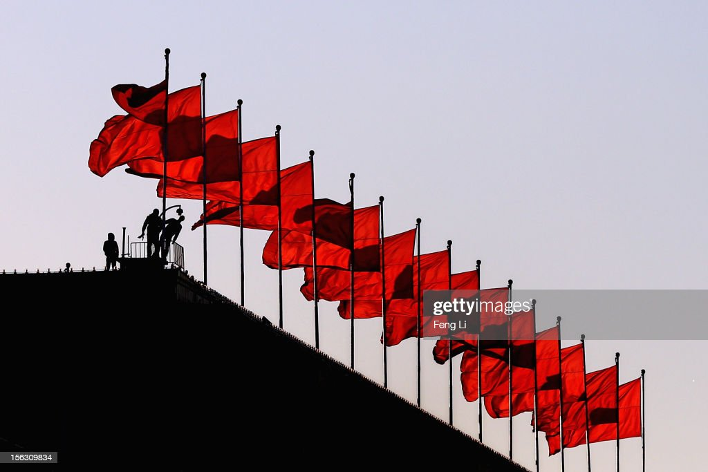 Workers check the security camera before the closing ceremony of 18th Communist Party Congress on the top of Great Hall of the People on November 13, 2012 in Beijing, China. The 18th National Congress of the Communist Party of China (CPC) will close Wednesday morning after electing members and alternate members of a new CPC Central Committee and members of a new Central Commission for Discipline Inspection.