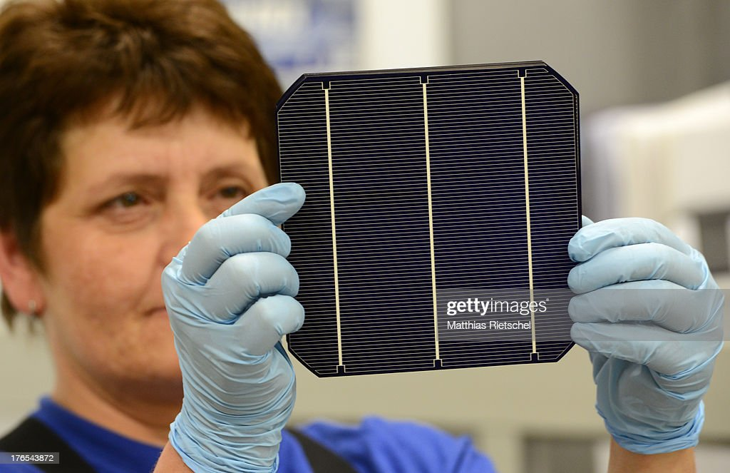 A workers checks solar energy cells at the Solarworld plant on August 14, 2013 in Freiberg, Germany. The troubled solar cells, modules and panels producer managed to recently avoid bankruptcy by reaching an agreement with its shareholders and other investors. Many solar energy equipment producers in Germany are facing difficult times due to stiff competition from China.