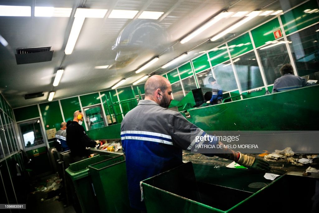 Workers classify garbage for recycling at Valorsul, a waste treatment plant, in Lisbon on January 22, 2013.