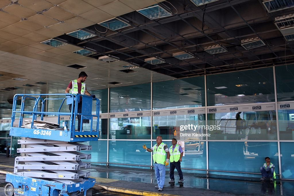 Workers clean the debris from yesterday's blasts as they take a break at Turkey's largest airport, Istanbul Ataturk, June 29, 2016, Turkey. Three suicide bombers opened fire before blowing themselves up at the entrance to the main international airport in Istanbul yesterday, killing at least 36 people and wounding 147 people according to PM Binali Yildirim.