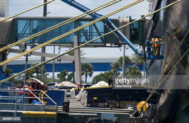 Workers clean the exterior of the Disney Dream cruise ship at Port Canaveral in Cape Canaveral Florida US on Wednesday July 5 2017 The US Census...