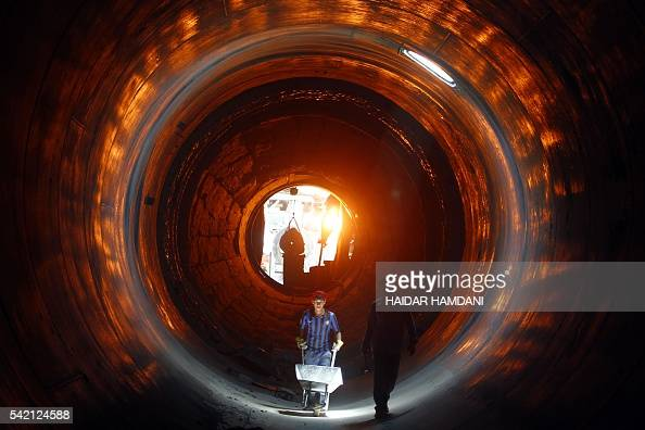 Inside Cement Kiln : Workers clean the inside of a kiln at kufa cement