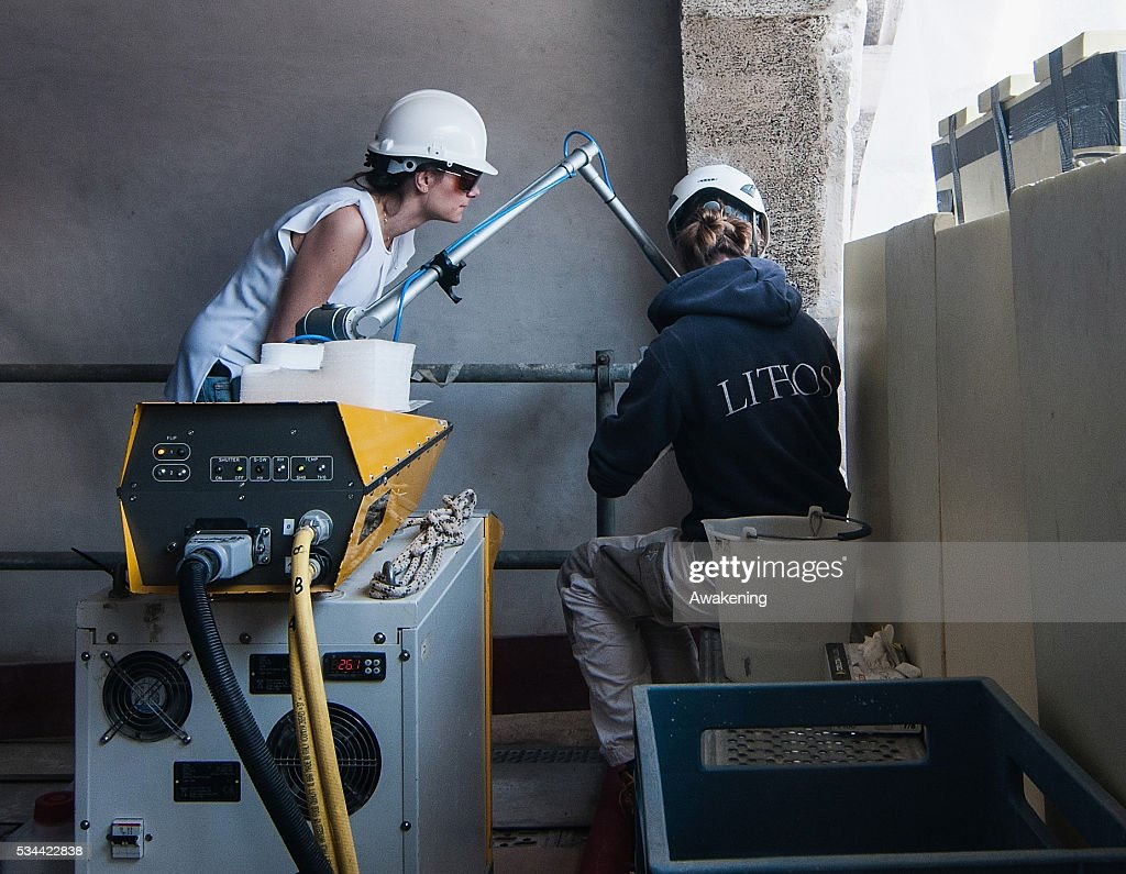 Workers clean the marble using a laser during the renovation of the Rialto Bridge on May 26, 2016 in Venice, Italy. Site visits were organized to see the renovation of the Rialto bridge to coincide with the 15th Biennale of Architecture in Venice.