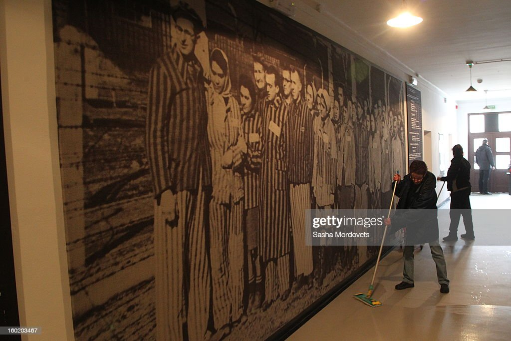 Workers clean the renovated Russian exposition in the museum at the former Auschwitz Birkenau Nazi concentration camp January 27, 2013 near Oswiecim, Poland. A ceremony marked the 68th anniversary of the liberation of the camp during International Holocaust Remembrance Day.