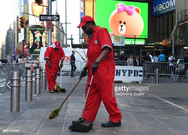 TOPSHOT Workers clean the sidewalk in Times Square May 19 2017 the morning after Richard Rojas crashed his car into a a crowd of pedestrians in New...