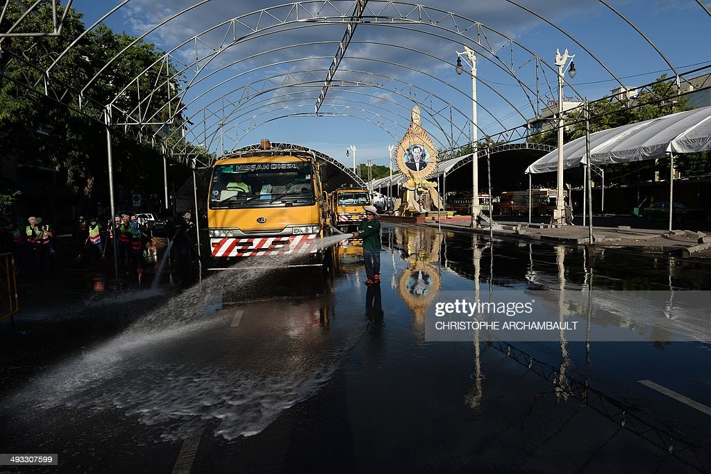 Workers clean the site of months of antigovernment protests at Democracy Monument a day after the Thai army seized power in Bangkok on May 23 2014...