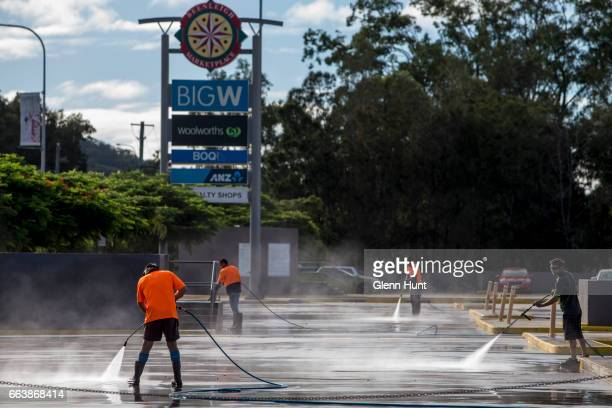 Workers clean up at a shopping centre after flooding on April 3 2017 in Beenleigh Australia Heavy rain caused flash flooding across south east...