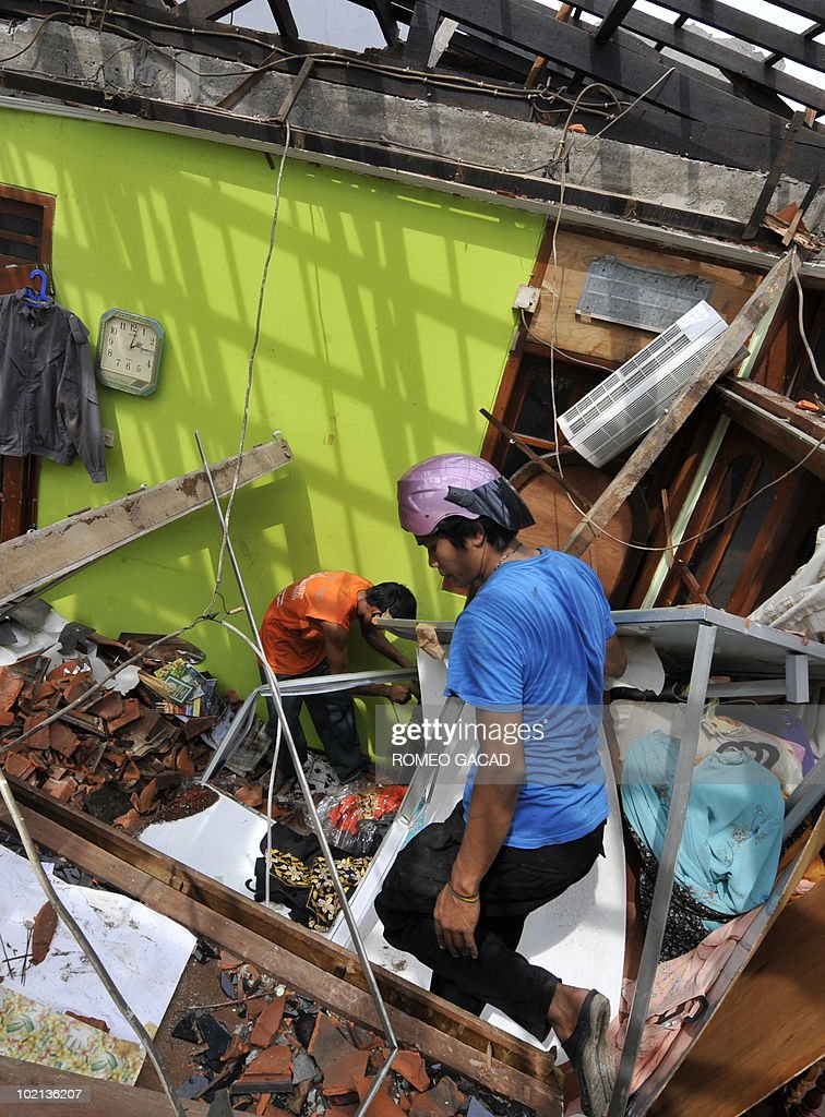Workers clean up debris from the bedroom of a two-storey residence after being hit by a meteor, located in Delima street, eastern Jakarta on May 4, 2010. Following investigations by the Indonesian National Aeronautics and Space Agency and police forensic teams, it was concluded on May 3, that the incident was a meteorological accident and the explosion was caused by a meteor. The owner Soedarmojo and his wife were away when the meteor's impact heavily damaged the house and two adjoining residences at 4.30 in the afternoon (0930 GMT) of April 29, 2010. Authorities said they are still searching for meteorite pieces in the rubble and advised the community to surrender any meteorite pieces they find.